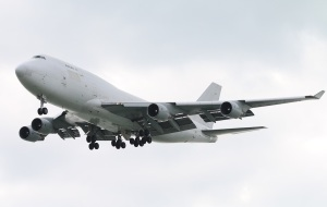 Unmarked Boeing 747-409(BDSF) belonging to Aerotranscargo landing on RWY07R of Hong Kong International Airport.