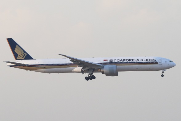 Singapore Airlines Boeing 777-312ER (9V-SWK) landing on RWY07L of Hong Kong International Airport.